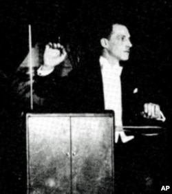 Inventor Leon Theremin playing his instrument in concert, c. 1924.