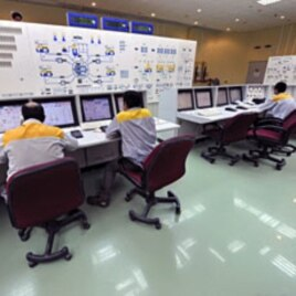 Photo taken August 23, 2010 shows Iranian technicians working at Bushehr nuclear power plant, outside the southern city of Bushehr. Iran's nuclear chief said a malicious computer worm known as Stuxnet has not harmed the country's atomic program and accuse