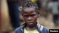 A girl walks along a street in the sprawling Kibera slum, in Nairobi, Kenya, Aug. 26, 2011.
