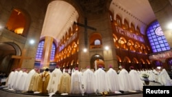 Priests take part in a mass held by Pope Francis in the Basilica of the Madonna of Aparecida, in Aparecida do Norte, Sao Paulo State, July 24, 2013.