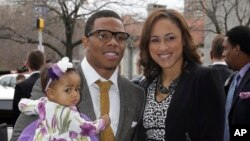 In this March 11, 2013 file photo, Baltimore Ravens running back Ray Rice, left, poses with his daughter, Rayven, and Janay Palmer.