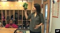 Teacher Hannah Chen uses spinach as a prop during a 3rd grade math class at E.W. Stokes Public Charter School in Washington, D.C.