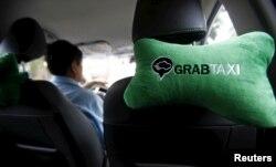 A GrabTaxi logo is seen on a car neck pillow in a taxi in Hanoi, Vietnam Sept. 9, 2015.