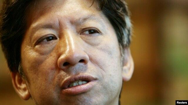 FILE - Pan-democrat legislator Ronny Tong speaks during an interview in Hong Kong.