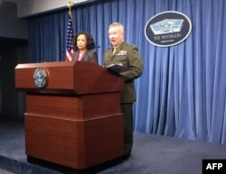 Pentagon spokeswoman Dana White and Marine Lt. Gen. Kenneth McKenzie Jr. brief the media at the Pentagon in this April 5, 2018 photo in Washington, D.C.