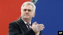 Serbia's Progressive Party leader Tomislav Nikolic attends a protest rally in Belgrade, Serbia, April 16, 2011