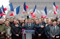 FILE - French conservative presidential candidate Francois Fillon delivers his speech during a rally in Paris, March 5, 2017.