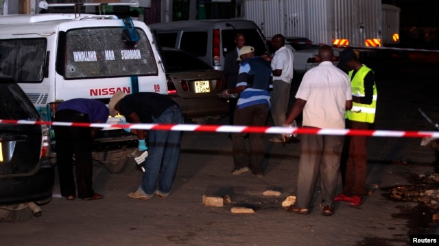 FILE - Bomb experts carry out investigations at the scene of an explosion along Biashara street in the Kenyan coastal city of Mombasa, May 22, 2014.