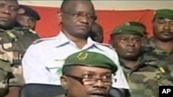 Niger millitary junta spokesman, Colonel Gokoye Abdul Karimou, speaking on state television in Niamey (file photo)