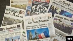 Trang nhất của các báo quốc tế tường trình về cuộc tuần hành tưởng niệm nạn nhân của các cuộc tấn công khủng bố ở Paris, Frankfurt, Đức hôm 12/1/2015. (EPA/BORIS ROESSLER)
