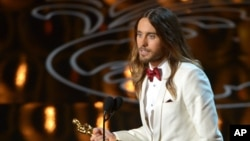 """FILE - Jared Leto accepts the award for best actor in a supporting role for """"Dallas Buyers Club"""" during the Oscars at the Dolby Theatre on March 2, 2014."""