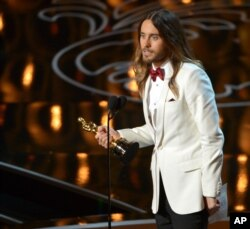 "Jared Leto accepts the award for best actor in a supporting role for ""Dallas Buyers Club"" during the Oscars at the Dolby Theatre on March 2, 2014, in Los Angeles."