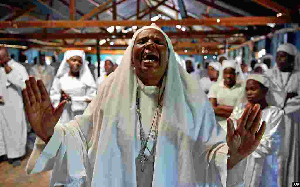 A woman screams during a special prayer for the victims of the Westgate Mall massacre at the Legio Maria African Mission church in Nairobi, Kenya.