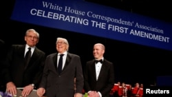 Former Washington Post reporters Bob Woodward (left to right) and Carl Bernstein stand with White House Correspondents' Association President Jeff Mason of Reuters at the head table before the association's dinner in Washington, April 29, 2017.