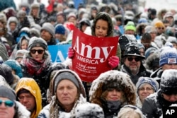 A young person holds a sign as Democratic Sen. Amy Klobuchar of Minnesota announces she is entering the race for president during a rally, Feb. 10, 2019, at Boom Island Park in Minneapolis, Minnesota.