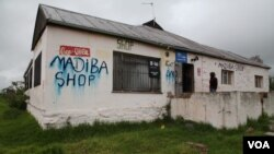 "Across South Africa's Eastern Cape - home to Nelson Mandela's boyhood village of Qunu - shops and houses are painted with his nickname ""Madiba"" and blurred by heavy rains, which in his culture means a great man has passed. (Hannah McNeish for VOA)"