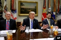 FILE - President Donald Trump, flanked by Senate Majority Leader Mitch McConnell (R-Kentucky), left, and House Speaker Paul Ryan (R-Wisconsin), speaks during a meeting in the Roosevelt Room of the White House in Washington, March 1, 2017. Trump is meeting with congressional Republican leaders Tuesday.