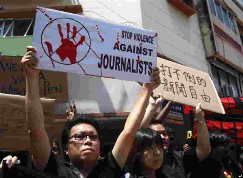 Los miembros de la prensa conmemorar el Día Mundial de la Libertad de Prensa en Kuala Lumpur, Malasia.