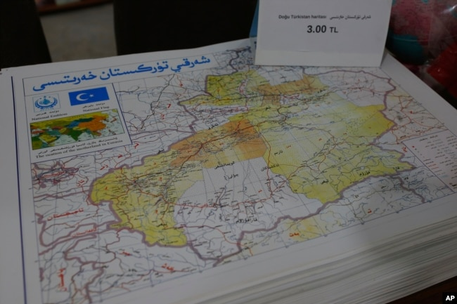 "A map showing ""East Turkistan,"" the name Uighurs who oppose Chinese rule call their homeland, a region China refers to as Xinjiang is seen at a bookstore in Istanbul's Zeytinburnu neighborhood, Dec. 14, 2017."