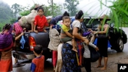 FILE - Ethnic Karen have abandoned a camp and villages in eastern Burma to seek refuge in Thailand following government attacks on ethnic insurgents.