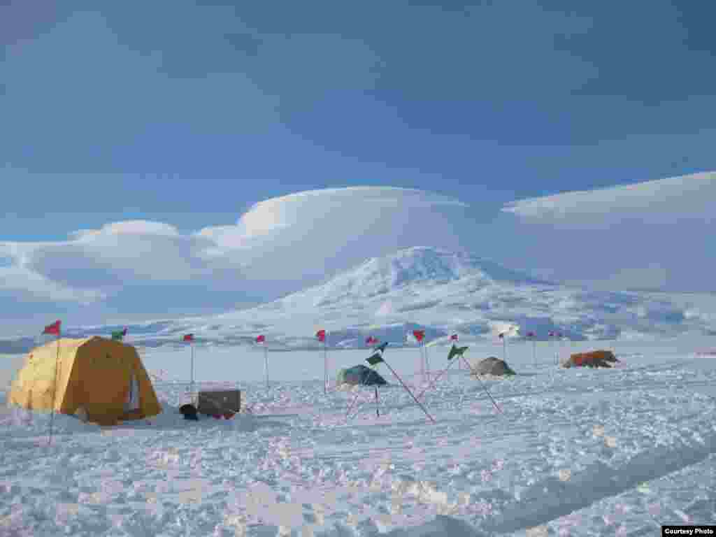 Base camp on the McMurdo Ice Shelf floats on a 200-meter- thick ice shelf, which in turn floats on the ocean which is one kilometer deep at that point. (David Holland)