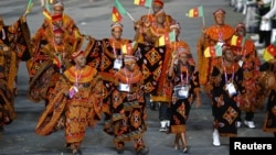Cameroon's athletes march on the parade during the opening ceremony of the London 2012 Olympic Games, at the Olympic Stadium, July 27, 2012.