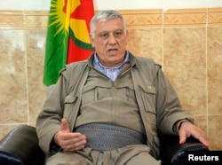 FILE - Cemil Bayik, a founding member of the Kurdistan Workers Party (PKK), is interviewed in the Qandil mountains near the Iraq-Turkey border, Oct.19, 2013.