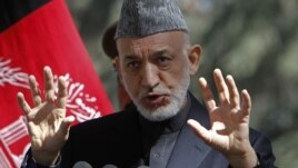 Afghan President Hamid Karzai speaks during a news conference in Kabul (file photo).