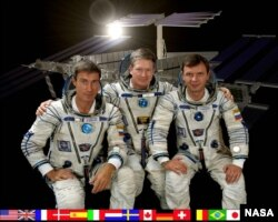 From left, Russia's Sergei Krikalev, American Bill Shepherd and Russia's Yuri Gidzenko are the first astronauts to live in the International Space Station. They left Earth on October 31, 2000 and opened the station two days later, (Photo courtesy of NASA)