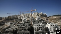 Houses under construction in a Jewish settlement near Jerusalem known to Israelis as Har Homa and to Palestinians as Jabal Abu Ghneim, 08 Dec 2010