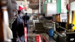 A worker monitors the bottling line at the Pampa beer factory in Bissau, Guinea-Bissau.