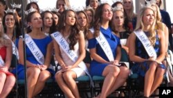 In this Aug. 30, 2017 photo, Miss America contestants sit during a welcoming ceremony in Atlantic City, N.J.