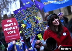 An anti-Brexit protester demonstrates outside the Houses of Parliament, ahead of a vote on Prime Minister Theresa May's Brexit deal, in London, Britain Jan. 15, 2019.