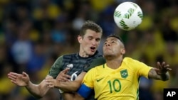FILE - Germany's Sven Bender, left, and Brazil's Neymar go for a header during the final match of the men's Olympic football tournament won by Brazil in Rio de Janeiro, Aug. 20, 2016.