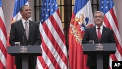 President Barack Obama and Chilean President Sebastian Pinera take part in a joint news conference in Santiago, Chile, Monday, March 21, 2011. (AP Photo/Pablo Martinez Monsivais)