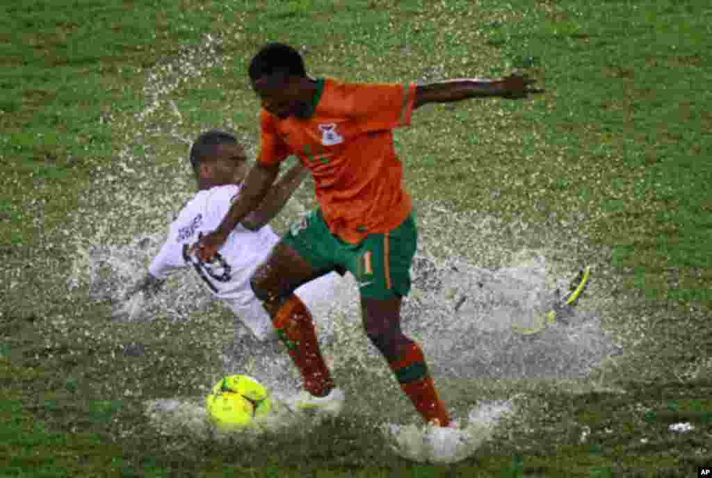 "Katongo of Zambia challenges Abubaker al Abaidy of Libya during their African Nations Cup Group A soccer match at Estadio de Bata ""Bata Stadium"", in Bata"