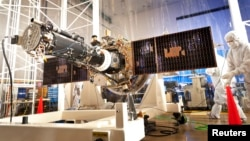 The fully integrated spacecraft and science instrument for NASA's Interface Region Imaging Spectrograph (IRIS) mission is seen in a clean room at the Lockheed Martin Space Systems Sunnyvale, California facility in this undated NASA handout photo.
