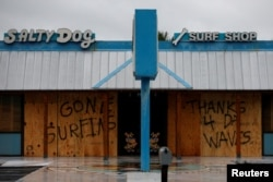 A message written on a closed business is pictured as Hurricane Michael approaches Panama City Beach, Florida, Oct. 10, 2018.