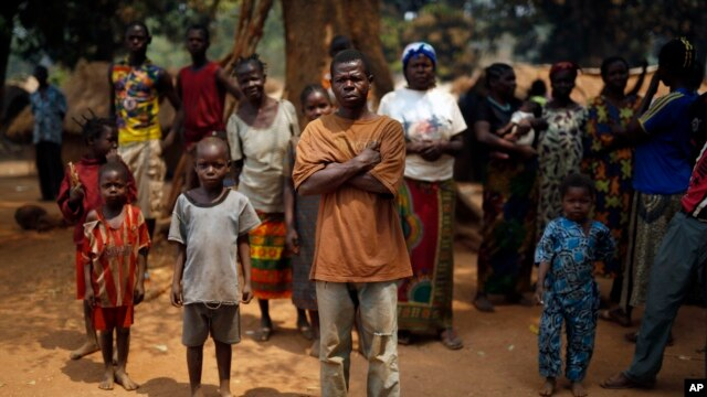 Christian families living in a refugee camp stand under a tree in Kaga-Bandoro, Central African Republic, Feb. 16,  2016.