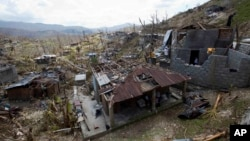 Homes destroyed by Hurricane Matthew stand in Moron, Haiti, Oct. 10, 2016.