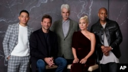 "Bradley Cooper, seated left, cast member and director of the film ""A Star is Born,"" poses with actors, from left, Anthony Ramos, Sam Elliott, Lady Gaga and Dave Chappelle at the Four Seasons Hotel during the Toronto International Film Festival."
