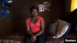 Fumana Ntontlo, 30, who says she was raped at age eight by a family member, sits in her one-room shack in Cape Town's Khayelitsha township. (file photo)