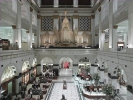 The grand court of Wannamaker's department store in Philadelphia holds the world's largest functioning pipe organ. It's still played twice a day, except on Sunday.