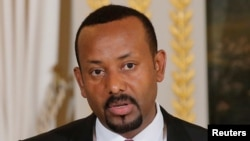 Ethiopian Prime Minister Abiy Ahmed meets members of opposition parties, Nov. 27, 2018, and promises fair elections.