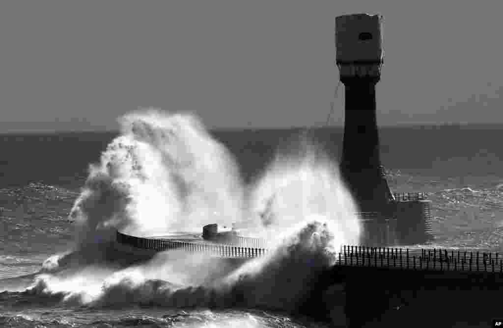 Heavy waves crash over Roker pier at Sunderland, England.