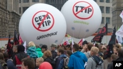 People demonstrate against the TTIP and CETA trade agreements in Leipzig, Germany, Sept. 17, 2016. Thousands of people are rallying in cities across Germany to protest against planned European Union trade deals with the United States and Canada.