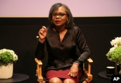 FILE - Anita Hill speaks at a discussion about sexual harassment at United Talent Agency in Beverly Hills, California, Dec. 8, 2017.