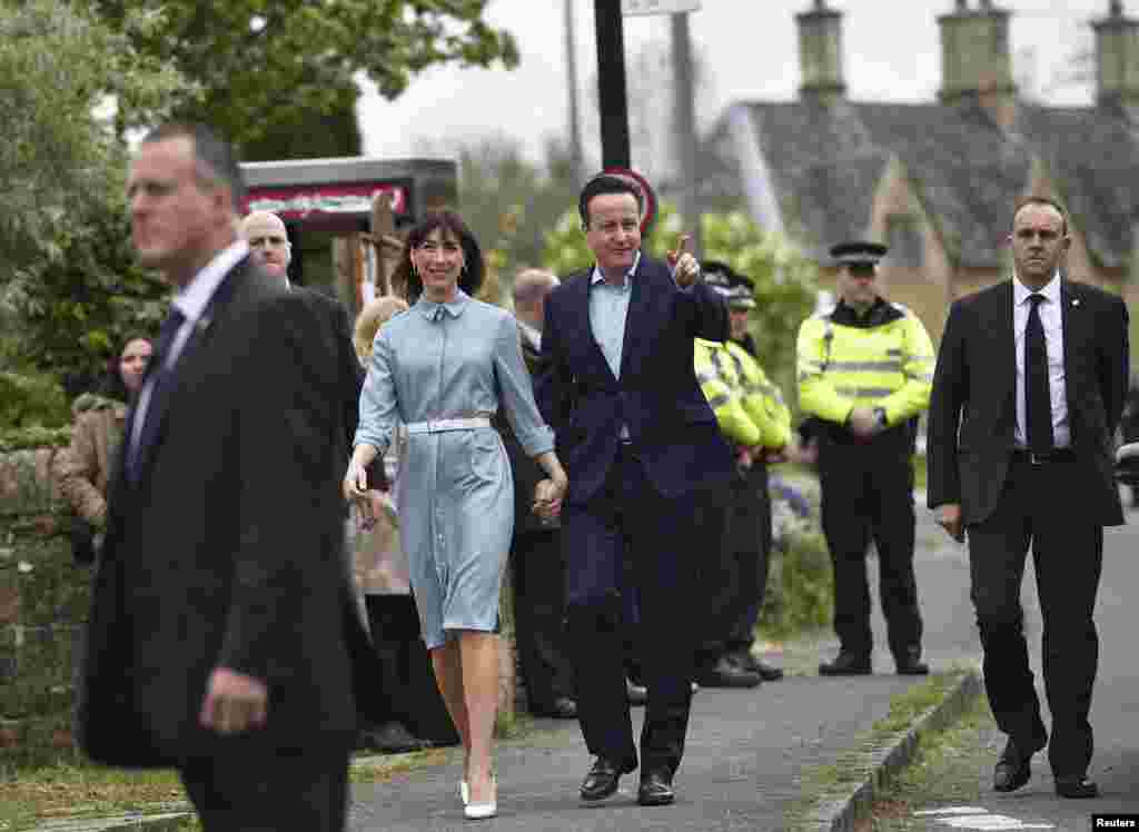 Prime Minister David Cameron arrives with his wife Samantha to vote in Spelsbury, May 7, 2015.