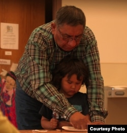 Tom Red Bird teaching Lakota at the Lakȟól'yapi Wahóȟpi Lakota immersion preschool in Fort Yates, ND. Courtesy: Florentine Films/Hott Productions