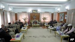 Nepal's prime minister Khadga Prasad Oli, centre, and top leaders sit during a meeting at prime minister's residence in Kathmandu, Nepal, Monday, Nov. 30, 2015.